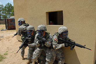 Airsoft gun - Soldiers with the US Army 187th Ordnance Battalion prepared to clear a room during urban combat training at the battalion's Field Training Exercise site.  The soldiers were armed with airsoft weapons as part of a pilot program in 2009.