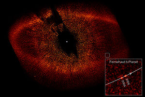 Debris disk - Hubble Space Telescope observation of the debris ring around Fomalhaut. The inner edge of the disk may have been shaped by the orbit of Fomalhaut b, at lower right.