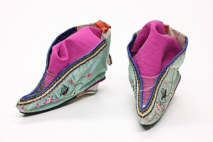 A pair of Chinese shoes from 1911 made for feet that have been bound in the Chinese foot binding custom.