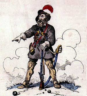 """Hecker uprising - Friedrich Hecker, depicted in an anti-Hecker, contemporary caricature outfitted in the """"revolutionary uniform"""" of a saber, musket, and the """"Hecker hat"""" which became associated with the revolutionaries."""