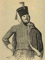 Sepia toned sketch of a man in a moustache dressed in a hussar uniform with a shako on his head. His right hand is on his hip and his head thrown back, giving him a jaunty look.