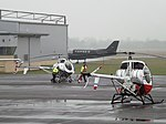 G-BOXT With G-ZZDD Two Hughes 269 Helicopters (32619672210).jpg