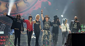 Guns N' Roses in 2017. From left to right: Dizzy Reed, Richard Fortus, Duff McKagan, Axl Rose, Slash, Melissa Reese and Frank Ferrer