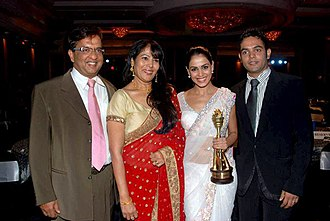 Genelia D'Souza - Genelia with her family at the CNBC Awaaz consumer awards in 2010. Seen here from left to right is her father Neil D'Souza, her mother Jeanette D'Souza, herself, and at the extreme right, her brother Nigel D'Souza.