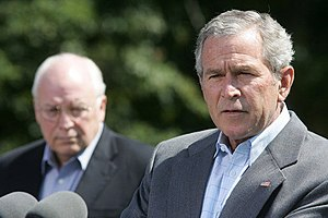President George W. Bush talks to reporters Fr...