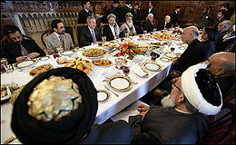 Politicians of Afghanistan having lunch with President Hamid Karzai and visiting U.S. President George W. Bush in Kabul on March 1, 2006.