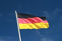 German Flag Flying aganist a Blue Sky.jpg