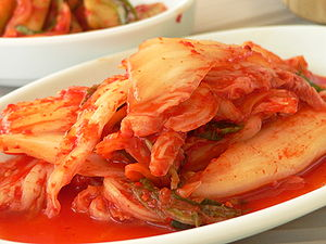 The Amazing Race: China Rush 3 - For one of the Detour choices in Yanji, each team member had to consume the popular and spicy Korean dish kimchi.