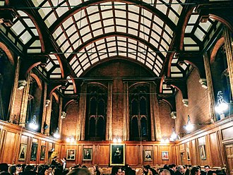 Girton College, Cambridge - The Great Hall is a grand Victorian hall featuring wood panelling and large dominating arched windows
