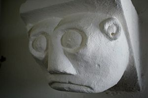 English: Glum face Corbel in St.Benedict's chu...