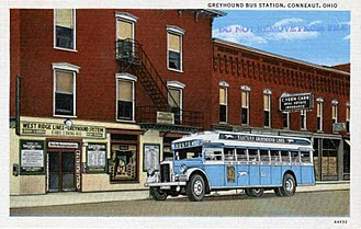 Greyhound Lines - An Eastern Greyhound Lines coach depicted at a stop in Ohio, c. 1930