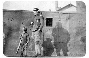 Gromobój (armoured train) - Polish soldier in front of the armoured train Gromobój in Sanok 1918.