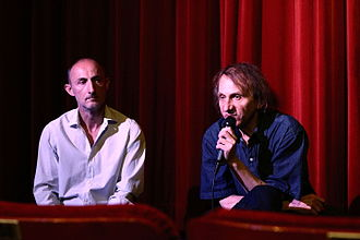 The Kidnapping of Michel Houellebecq - Nicloux and Houellebecq during a presentation of the film