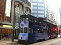 HK Sheung Wan Tram Station 上環電車站 Des Voeux Road Central tram body ads Happy Valley 紀雲峰 The Altitude Jan-2012.jpg