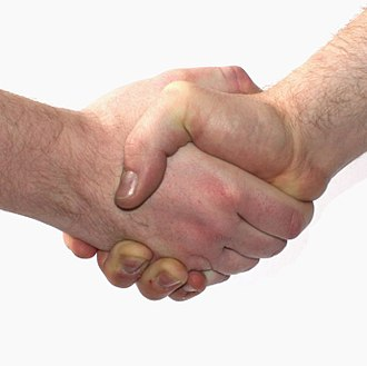 Tit for tat - In Western business cultures, a handshake when meeting someone is a signal of initial cooperation.