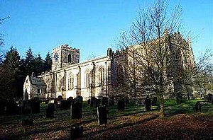 A long stone church seen from the southeast with a low tower at the far end