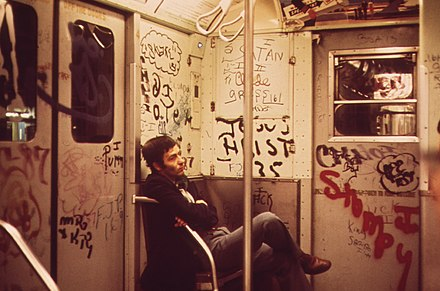 Graffiti became a notable symbol of declining service during the 1970s. Heavily tagged subway car in NY.jpg