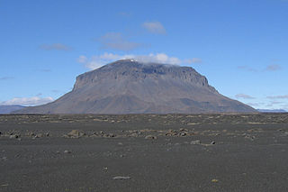 Tuya A flat-topped, steep-sided volcano formed when lava erupts through a thick glacier or ice sheet