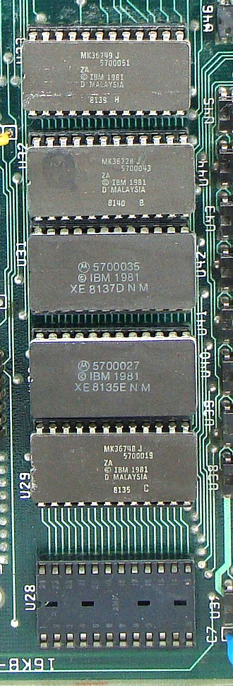 IBM BASIC - Five 8 KB ROM DIP chips and an empty 8 KB ROM expansion socket, on an IBM PC motherboard. Four chips hold Cassette BASIC, and one holds the BIOS.