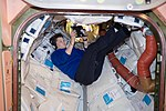 ISS-59 Anne McClain with an electronic tablet inside PMA-1.jpg