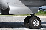JASDF YS-11P(02-1158) left main landing gear left front view at Miho Air Base May 27, 2018.jpg