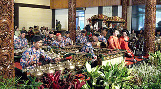Gamelan - Javanese gamelan ensemble with two female sindhen (choral singer) during traditional Javanese wedding at Sasono Utomo, Taman Mini Indonesia Indah, Jakarta, Indonesia