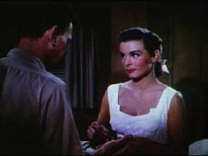Jean Peters - Peters mending Joseph Cotten's hand in Niagara (1953)