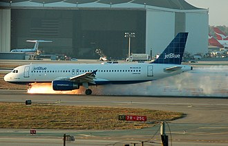 JetBlue Airways Flight 292, an Airbus A320, making an emergency landing on runway 25L at Los Angeles International Airport in 2005 after the front landing gear malfunctioned JetBlue292Landing.jpg