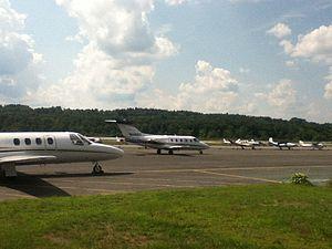 Fitchburg Municipal Airport - A Beechjet 400 passing a Cessna Citation I on the ramp