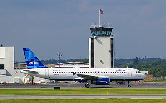 South Portland, Maine - jetBlue airliner at PWM, viewed from the South Portland side of the runway, 2009.