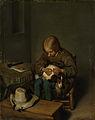 Jongen bezig een hondje te vlooien. Rijksmuseum SK-C-242.jpeg