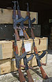 Kalashnikov AK-47 assault rifles lay stacked in a warehouse in Bosnia and Herzegovinia awaiting transportation to a steel works for smelting MOD 45148207.jpg