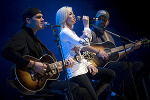 Kellie Pickler - Pickler and members of her band Ryan Ochsner, left, and Joshua Henson perform for U.S. service members during the first stop of the 2008 USO Holiday Tour on Ramstein Air Base, Germany, December 16, 2008