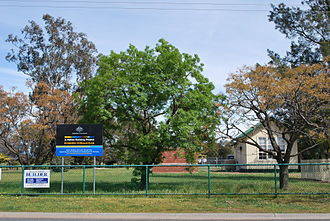 """National fiscal policy response to the Great Recession - A school in Australia with signage proclaiming the works as part of the """"Economic Stimulus Plan"""""""