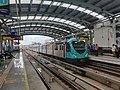 Kochi metro train at mg road station Ernakulam, Kerala, India.jpg