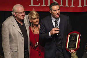 Kurt Warner - Kurt Warner inducted into the St. Louis Sports Hall of Fame. Coach Jim Hanifan and wife Brenda Warner, look on.