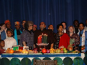 Maulana Karenga - Karenga, center, with wife Tiamoyo at left, celebrating Kwanzaa at the Rochester Institute of Technology on December 12, 2003