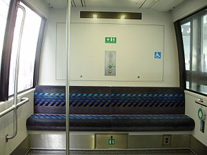 LINK Train - The interior of an unrefubished  LINK Train car showing the original seats.