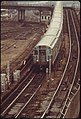 LONG ISLAND COMMUTER TRAIN ARRIVES TO INTERCONNECT WITH NEW YORK TRANSIT AUTHORITY SUBWAYS TO MANHATTAN. THE SUBWAY... - NARA - 556693.jpg