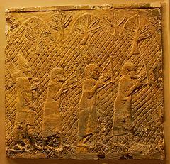 Foto van een scène uit Lachish Relief: Semitische mannen in Assyrische gevangenschap, spelen een latere vorm van de Egyptische lier