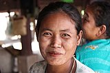 Laotian woman with bright eyes.jpg
