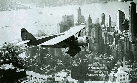 Lituanica above New York in 1933. The transatlantic flight was one of the most precise in aviation history. It equaled, and in some aspects surpassed, Charles Lindbergh's classic flight. Lituanica Above New York.jpg