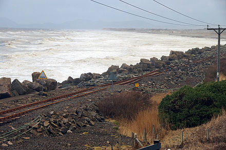 Wave damage caused 3 January 2014 at Llanaber railway station Llanaber rail storm damage 2014.jpg