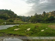 View of pasture and stream in Lund Khwar.