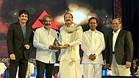 M. Venkaiah Naidu presenting the Akkineni Nageswara Rao National Film Award to the Film Director, Shri S.S. Rajamouli, in Hyderabad on September 17. 2017. The Chief Minister of Telangana, Shri Chandrashekar Rao, Film Actor.jpg
