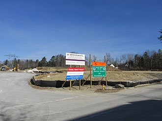 Wachusett station - Entrance to the station construction site in January 2013. Signs noting the contributions of the Federal Transit Administration (part of US DOT) are displayed.
