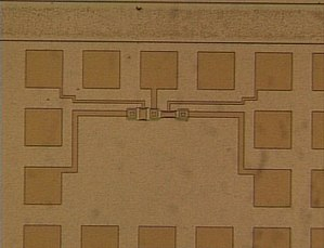 Photomicrograph of two MOSFETs in a test pattern