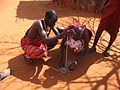 Maasai people lighting a fire in a Maasai village on the A109 road, Kenya.jpg