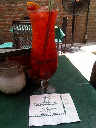 Hurricane (cocktail) - A hurricane served in the typical glass at Pat O'Brien's, New Orleans