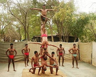 Mallakhamba - A mallakhamba team of the Indian Army's Bombay Sappers performs on the pole.